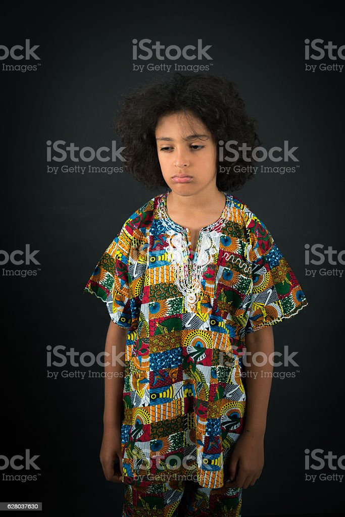 Handsome boy doing different expressions in different sets of clothes: tired stock photo