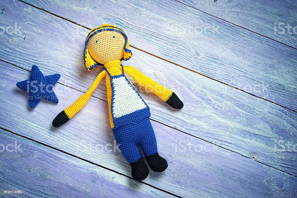 Handsome boy doll on blue wooden boards stock photo