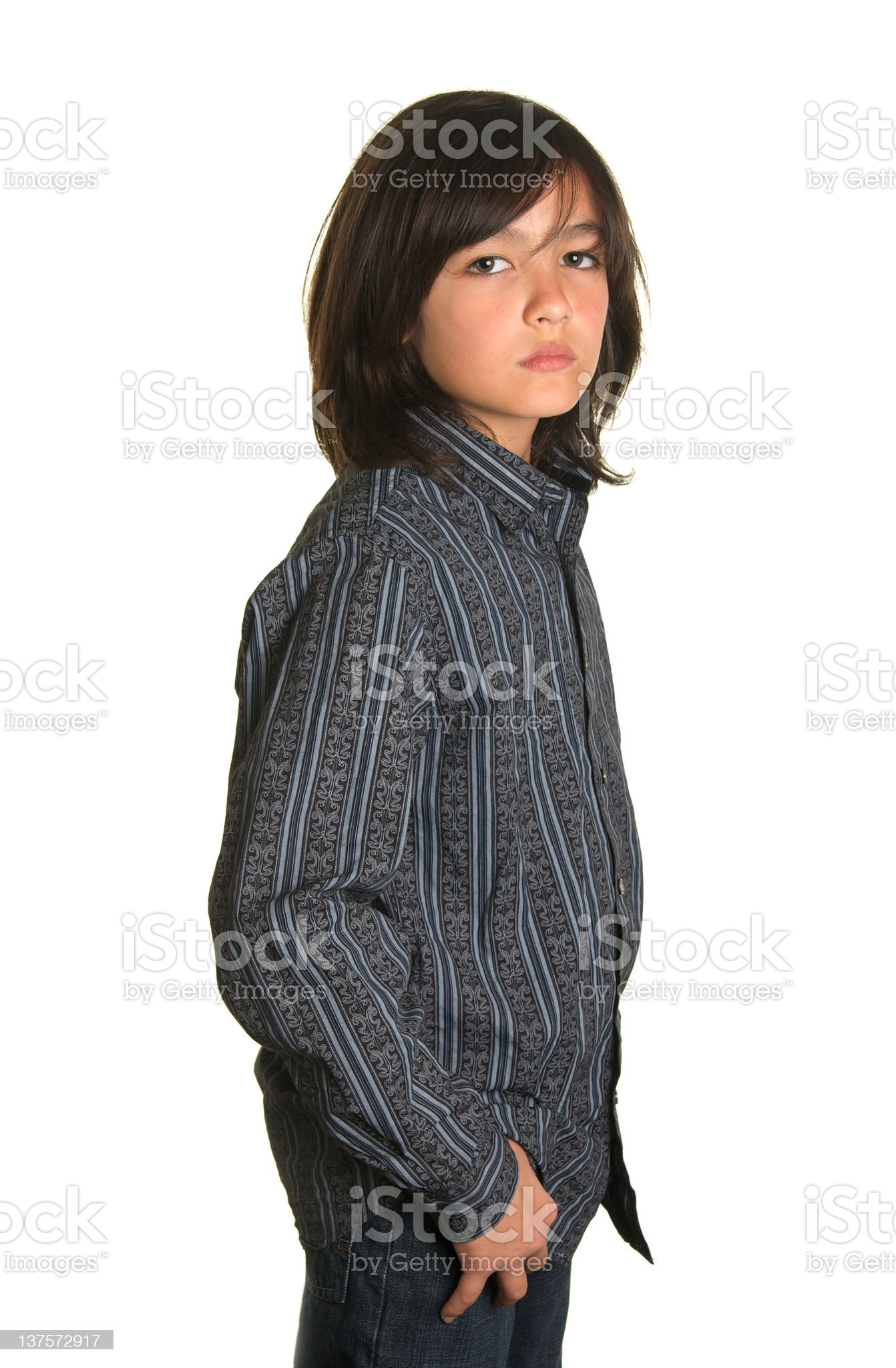 Handsome Boy Model with Long Hair Standing royalty-free stock photo