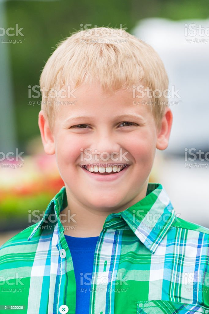 Handsome boy smiles confidently stock photo