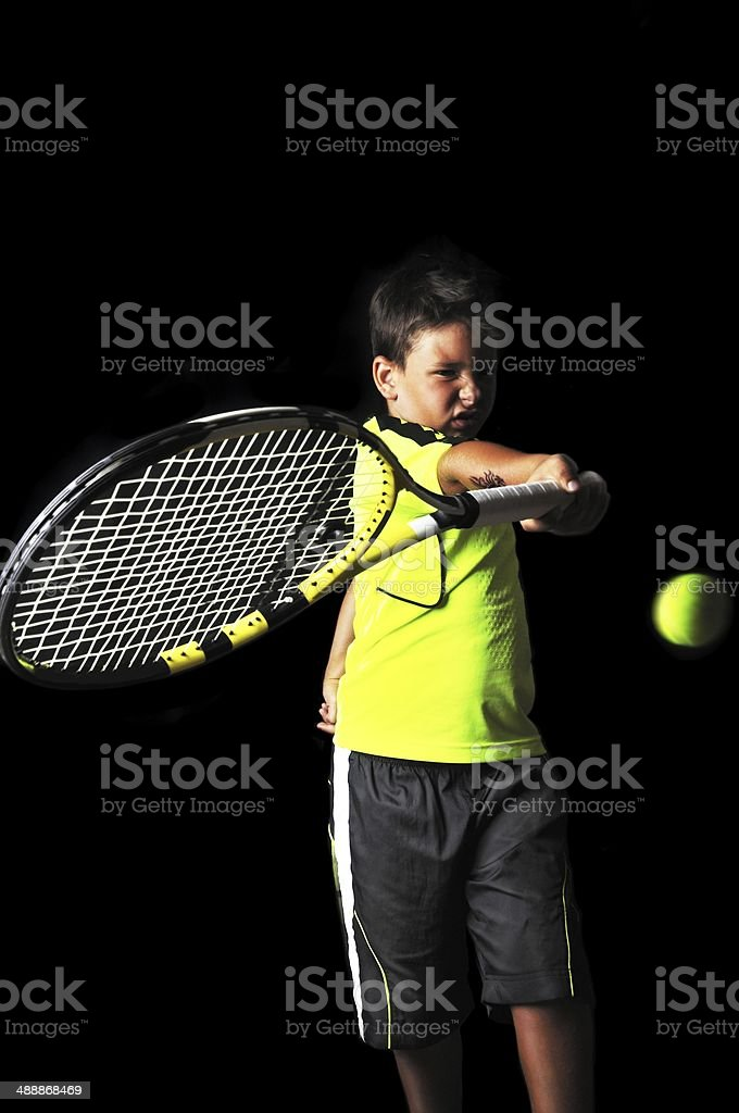 Handsome boy with tennis equipment playing forehand royalty-free stock photo