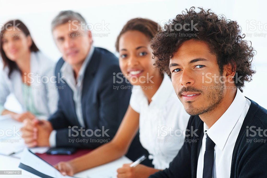 Handsome business colleagues sitting together in a row stock photo