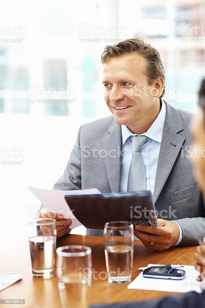 Handsome business man at a meeting with colleagues royalty-free stock photo