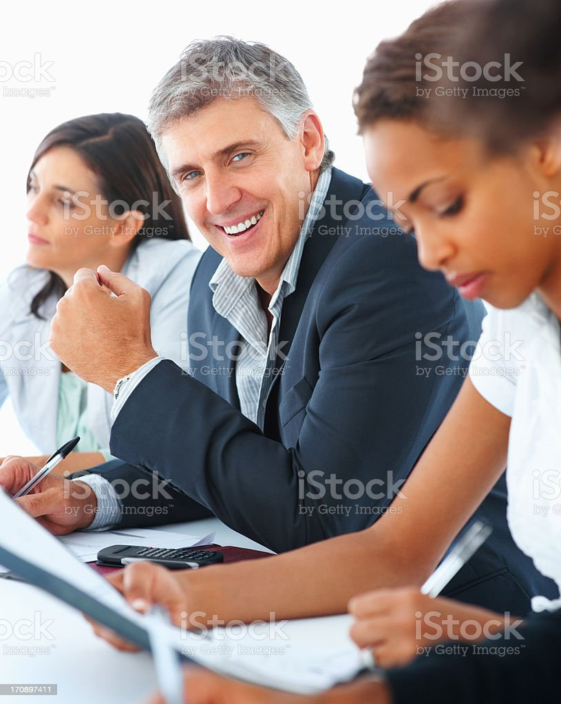 Handsome business man sitting a group with other colleagues stock photo