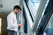 Handsome Business man using smart phone in office