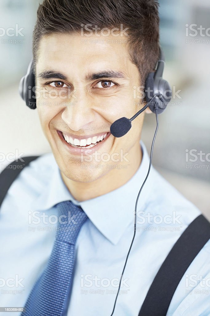 Handsome business man wearing a headset at work royalty-free stock photo