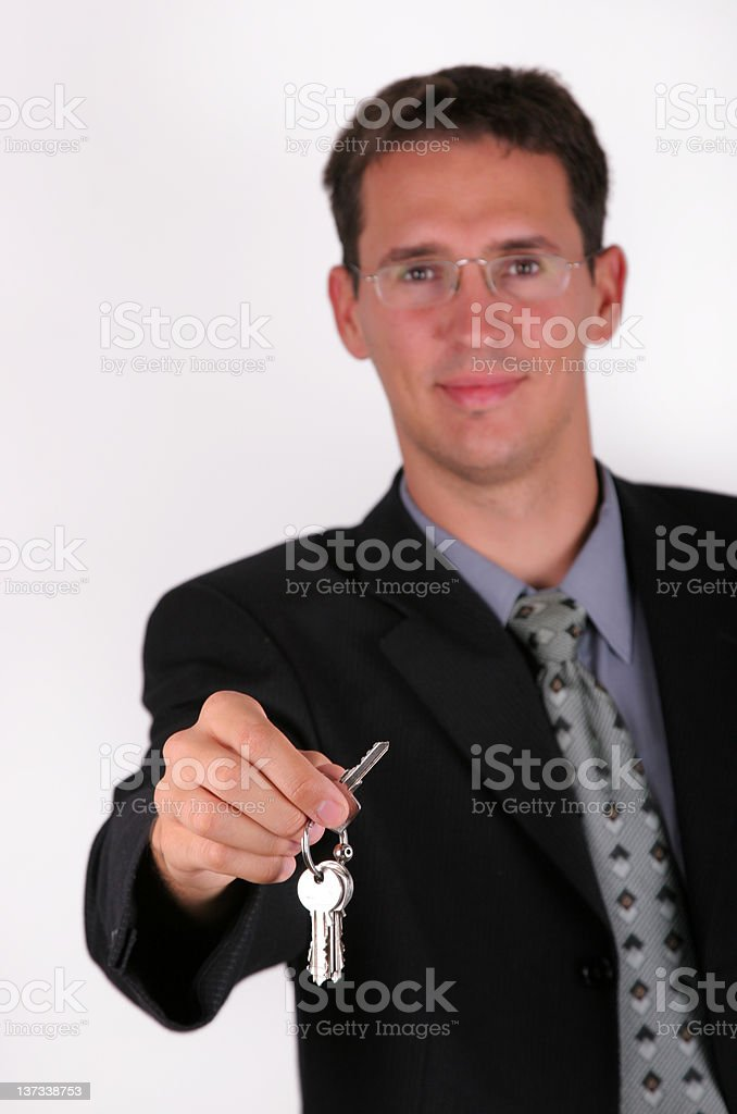 Handsome business men with key hand royalty-free stock photo
