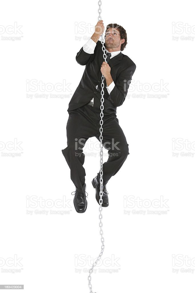Handsome businessman climbing up a rope chain royalty-free stock photo
