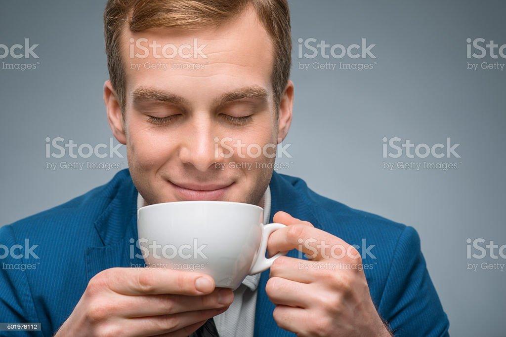 Handsome businessman enjoying his coffee stock photo