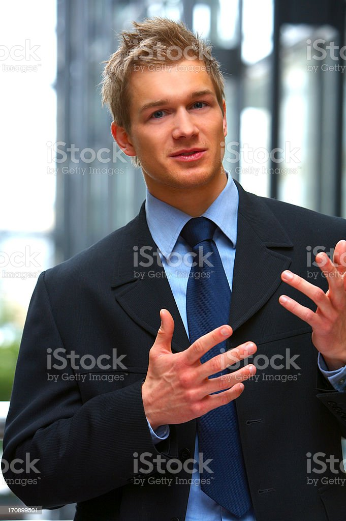 Handsome businessman explaining things royalty-free stock photo