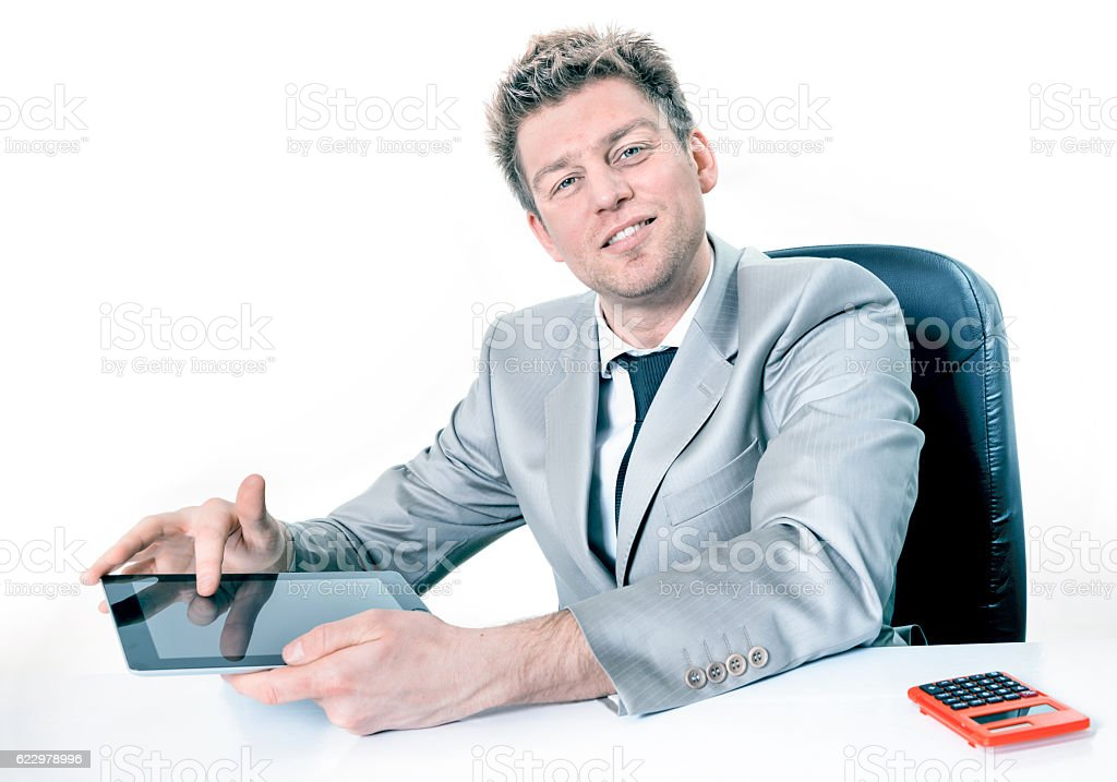 Handsome businessman hands are pointing on touch screen device stock photo