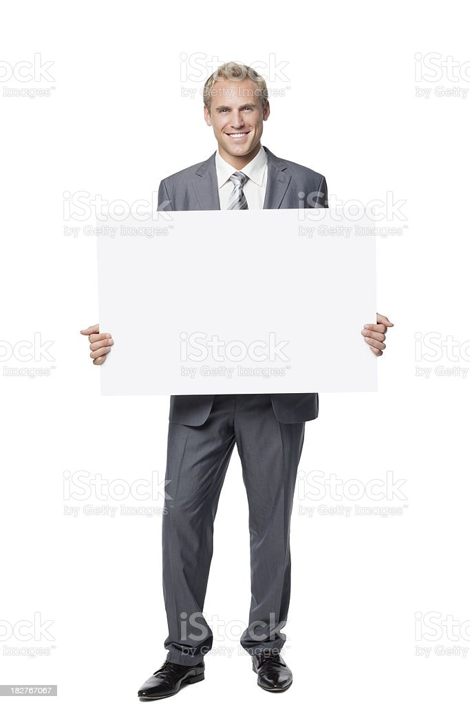 Handsome Businessman Holding a Blank Sign stock photo