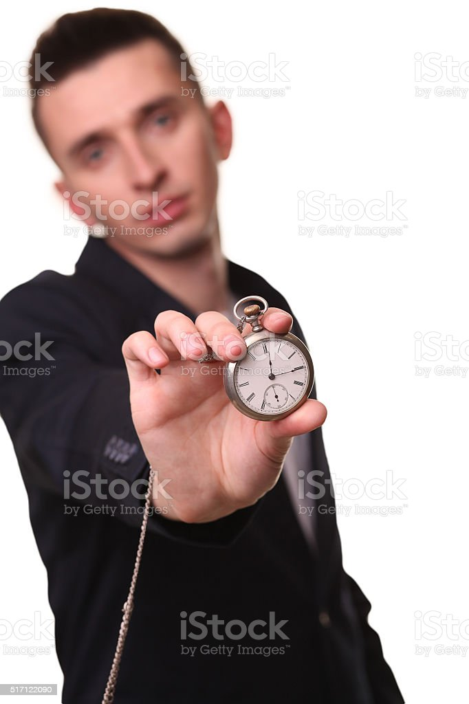 Handsome businessman holding a clock. Over white background royalty-free stock photo