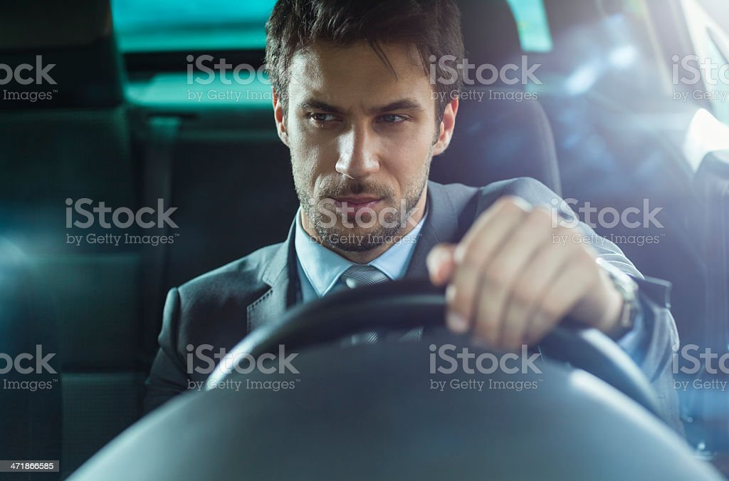 Handsome businessman in car royalty-free stock photo