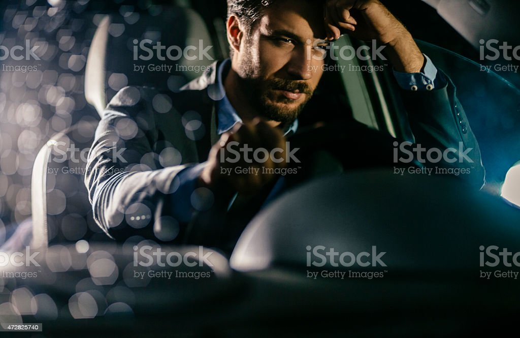 Handsome businessman in car stock photo