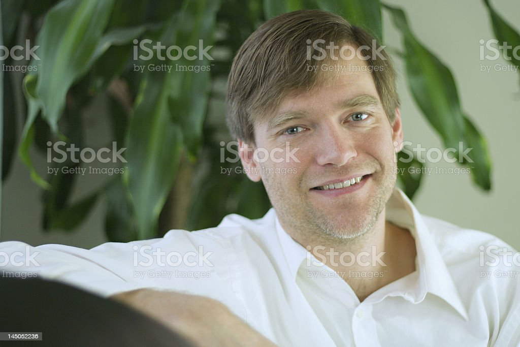Handsome businessman in casual attire relaxing. royalty-free stock photo