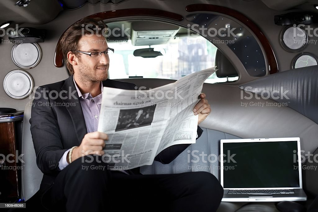 Handsome businessman in limousine stock photo