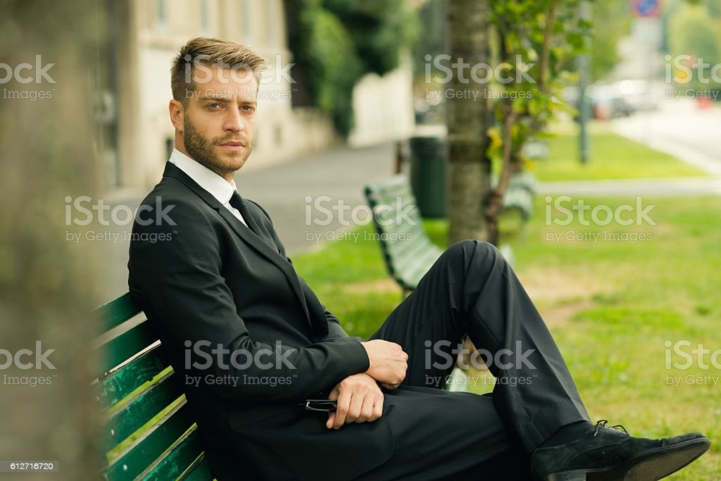 Handsome businessman looking at camera. stock photo