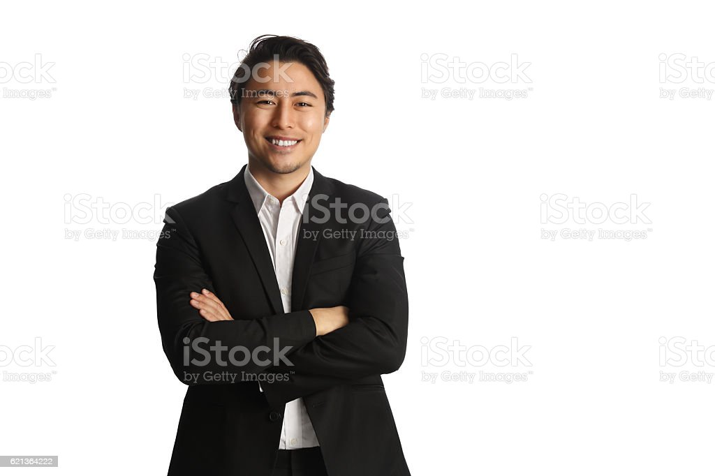 Handsome businessman looking at camera stock photo