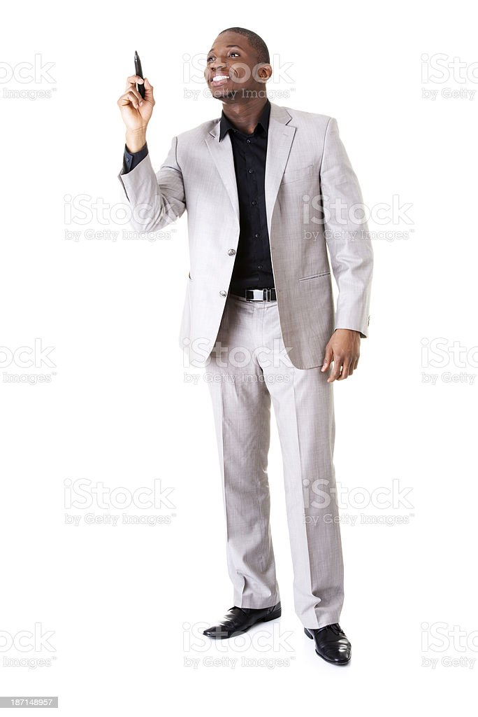Handsome businessman pointing on copy space with a pen. royalty-free stock photo