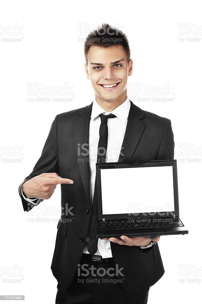 Handsome businessman pointing on laptop stock photo