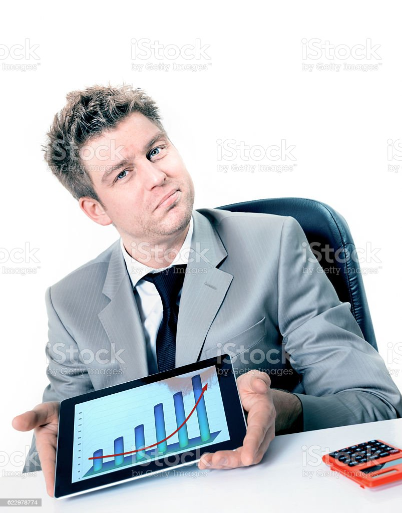 handsome businessman showing a positive business chart on his pad stock photo
