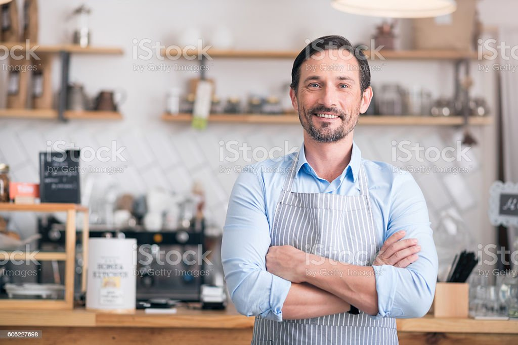 Handsome businessman showing his business stock photo