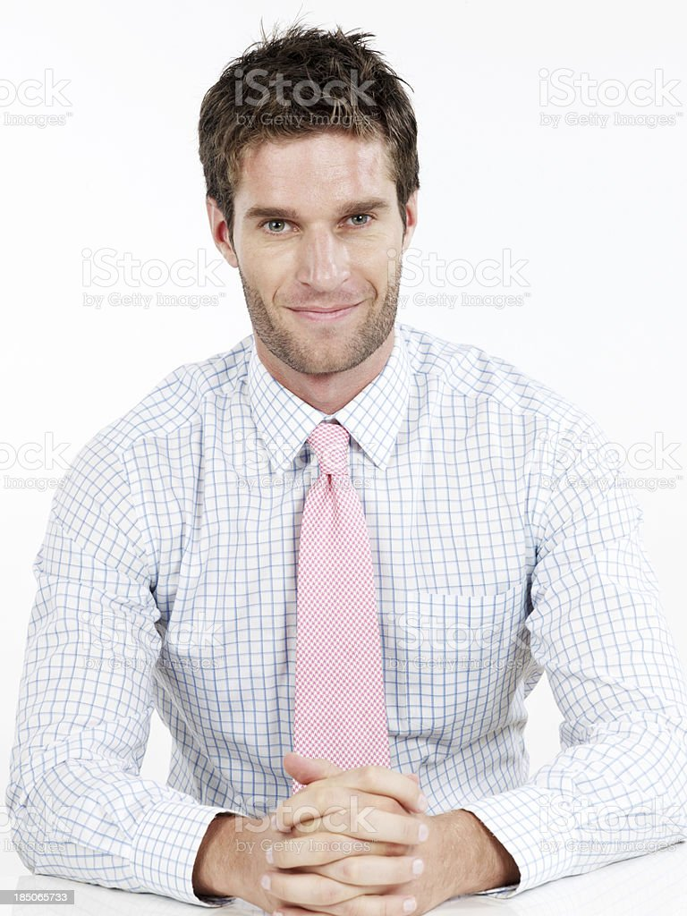 Handsome businessman sitting with hand crossed royalty-free stock photo