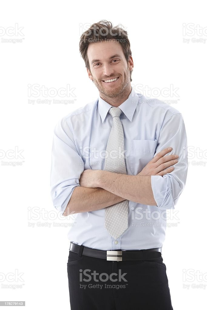 Handsome businessman smiling confidently stock photo