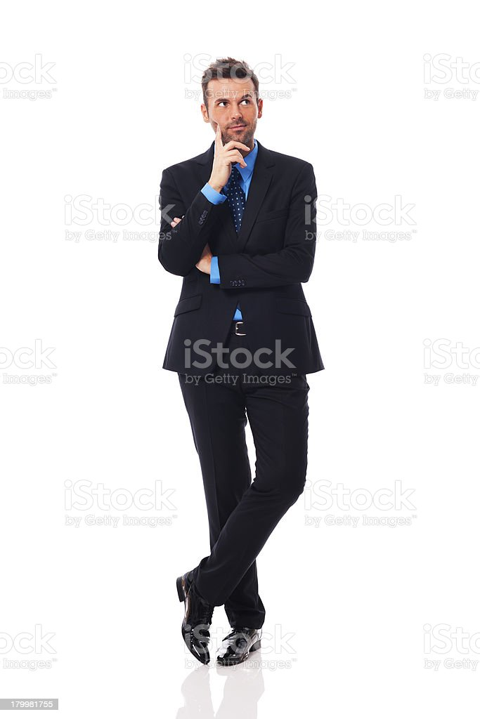Handsome businessman thinking about something stock photo