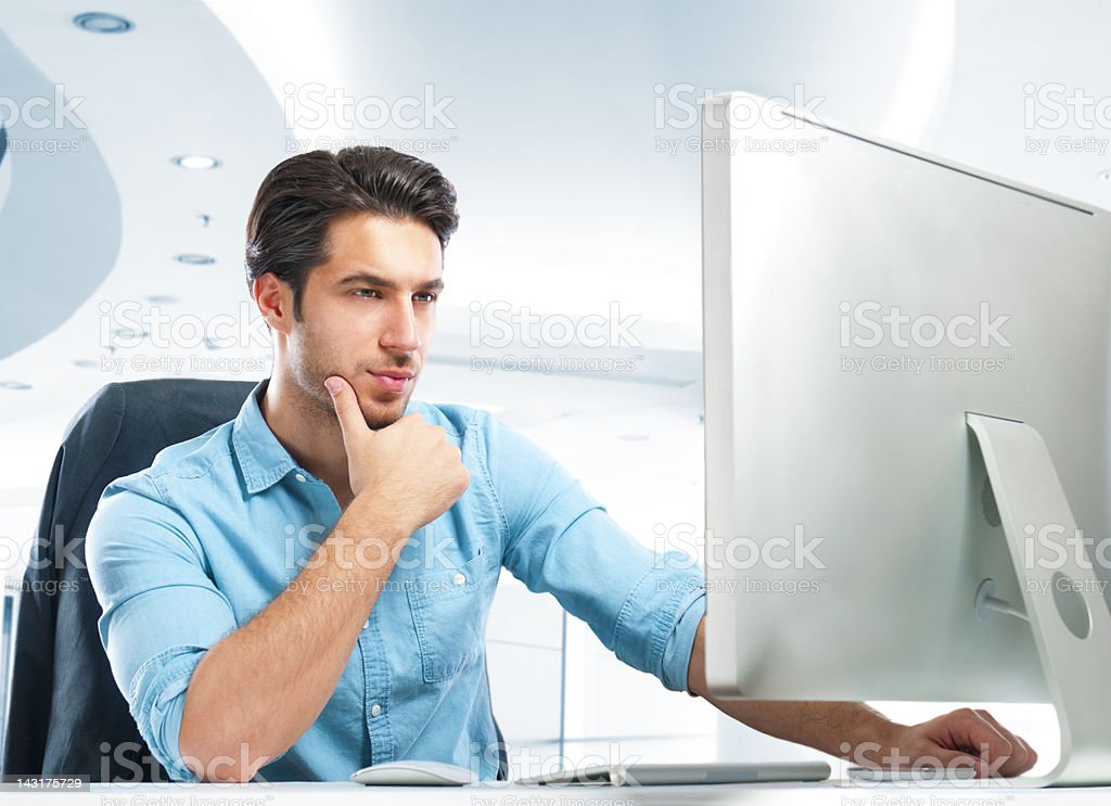 handsome businessman using computer royalty-free stock photo