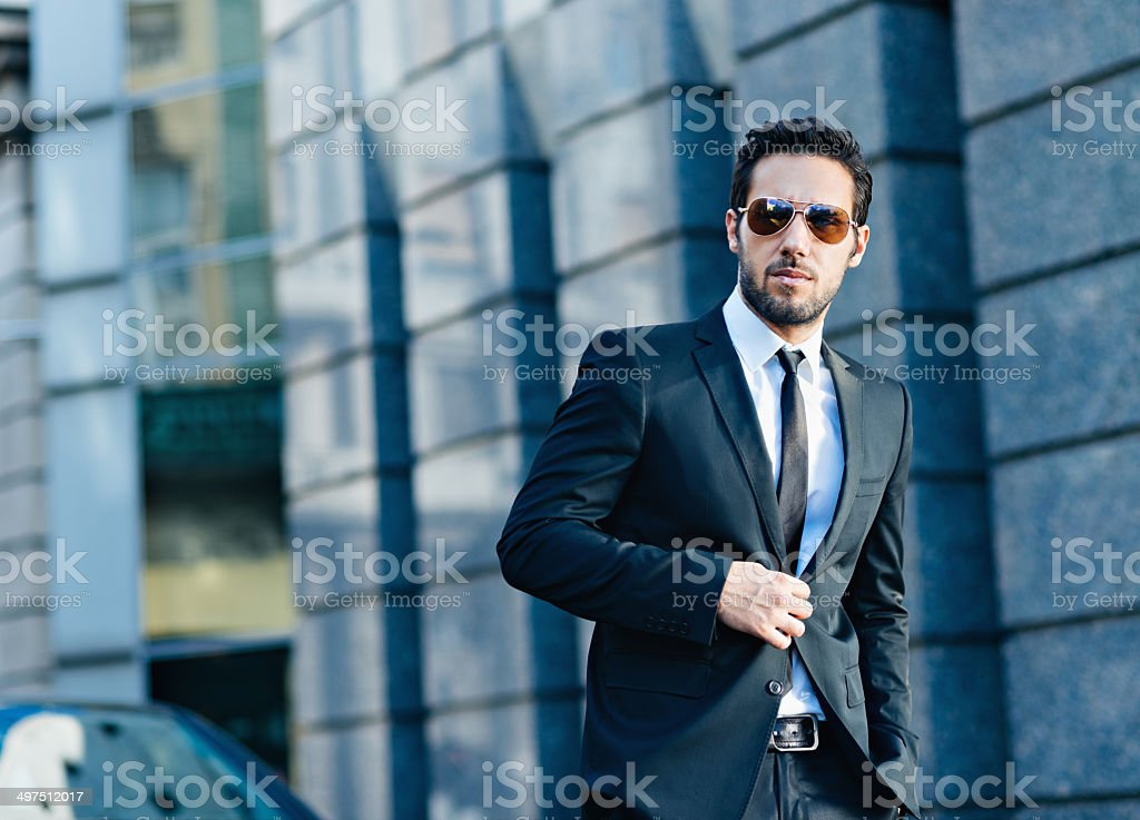 handsome businessman walking in the street stock photo
