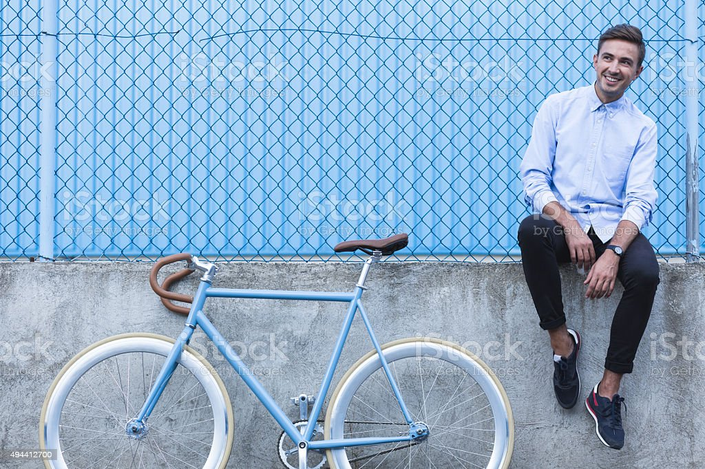 Handsome businessman with bike stock photo