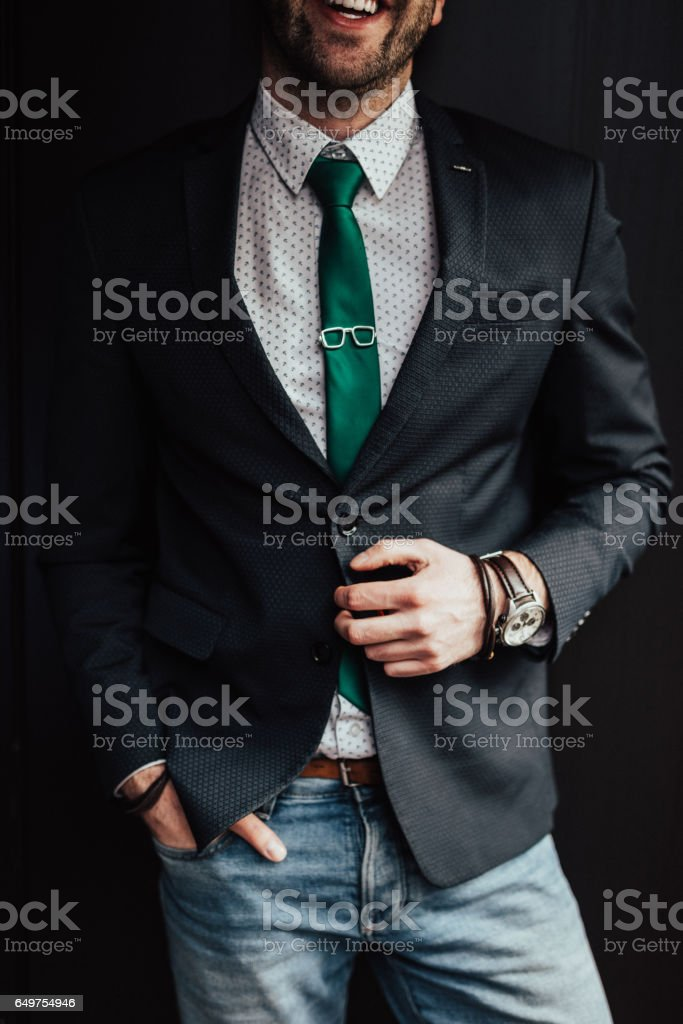 Handsome businessman with hand on jacket stock photo