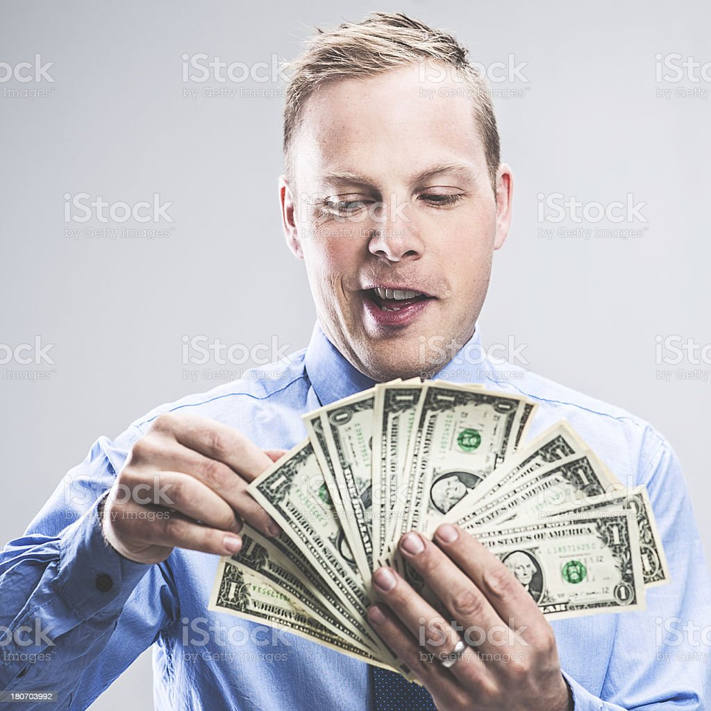 Handsome businessman with money royalty-free stock photo