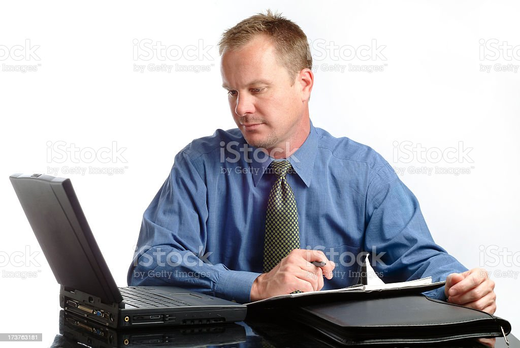 Handsome Businessman Working Hard at his Desk royalty-free stock photo