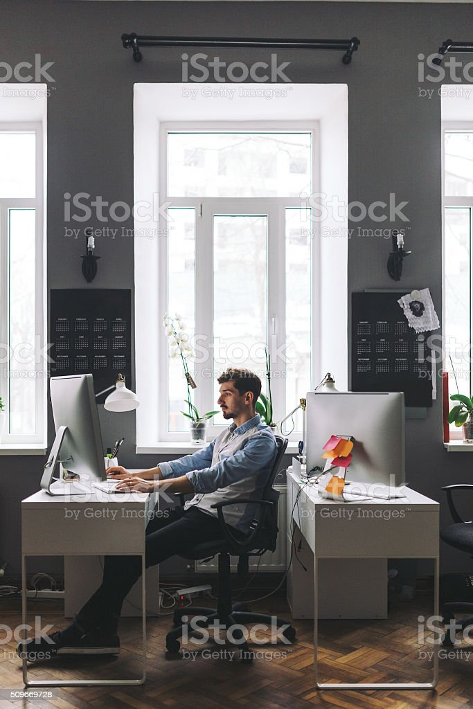 Handsome businessman working in office stock photo