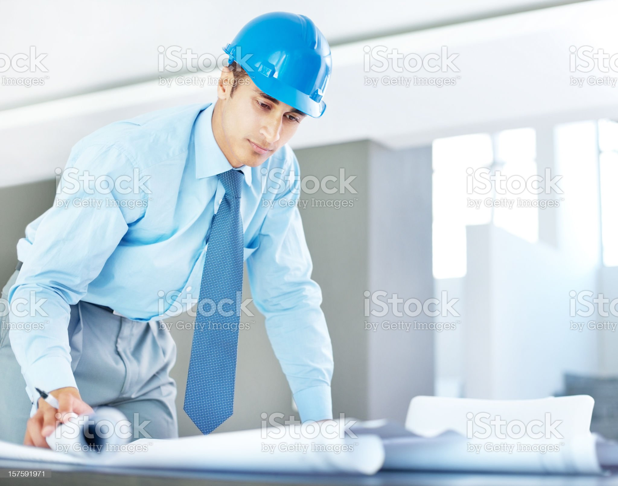 Handsome businessman working on blue prints royalty-free stock photo