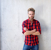 Handsome casual man with beard posing with arms crossed