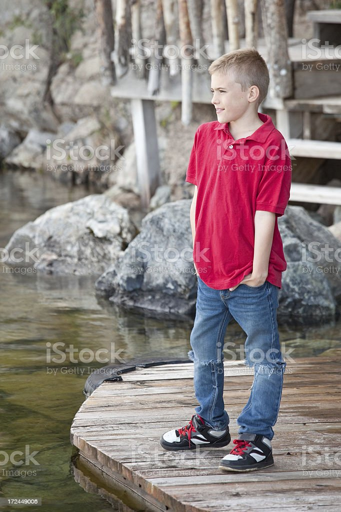 Handsome Caucasian Boy On A Dock royalty-free stock photo