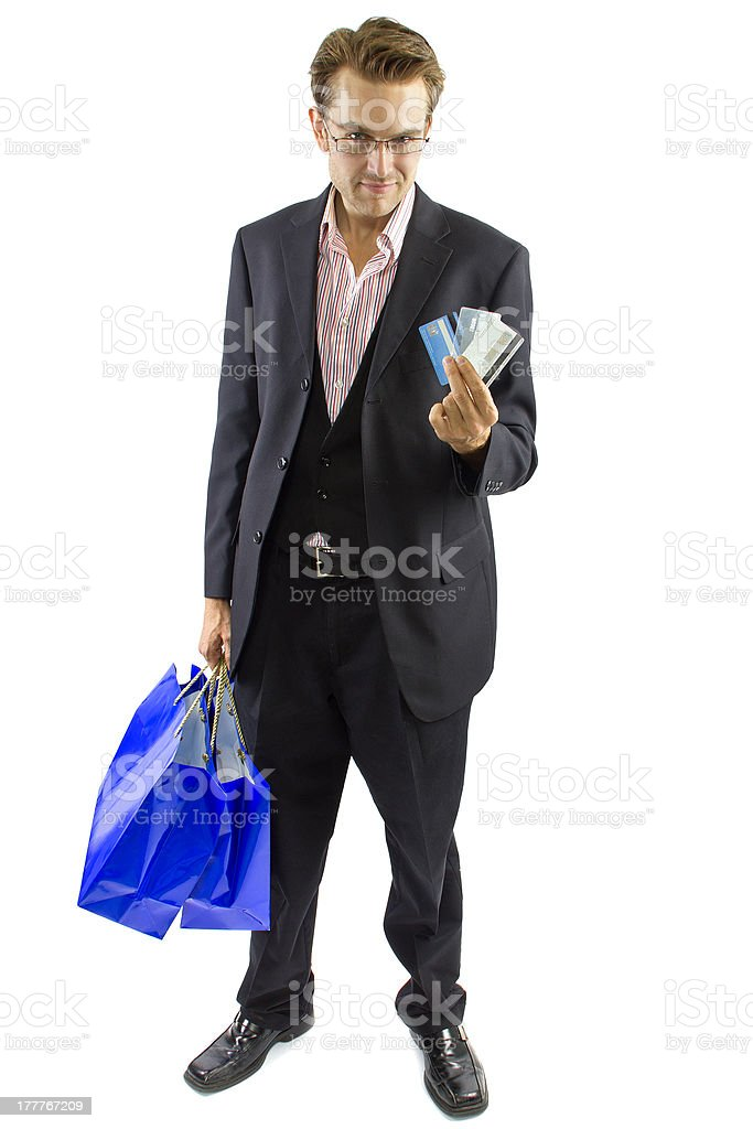 Handsome Caucasian Man Holding Blue Shopping Bags and Credit Cards stock photo