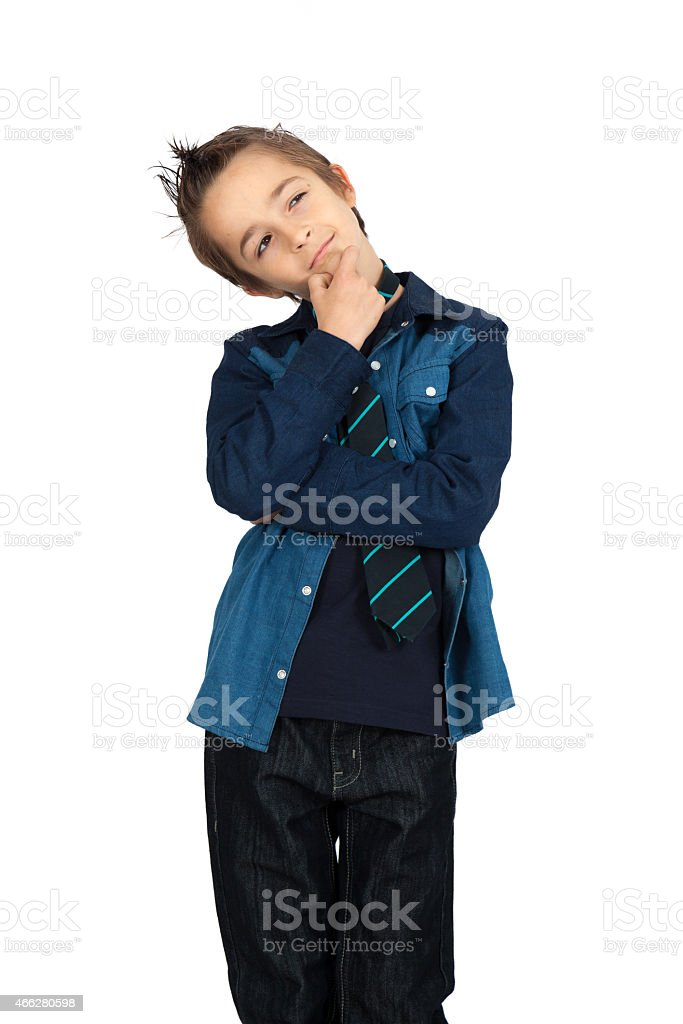 Handsome child doing different expressions in different sets of clothes stock photo