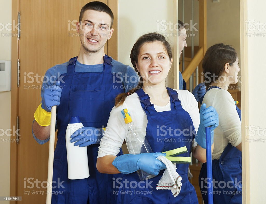 Handsome cleaners team is ready stock photo