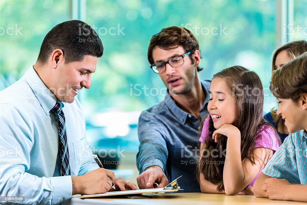 Handsome Client with family and consultant stock photo