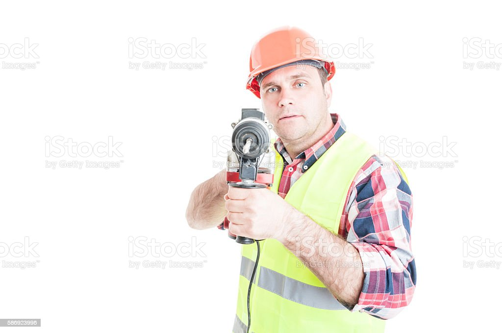Handsome constructor holding electric drilling machine stock photo
