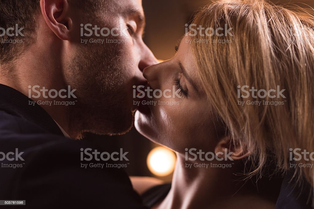 Handsome couple having French kiss stock photo