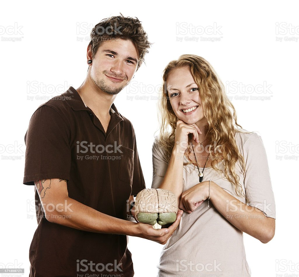 Handsome couple look up from anatomical model of human brain stock photo