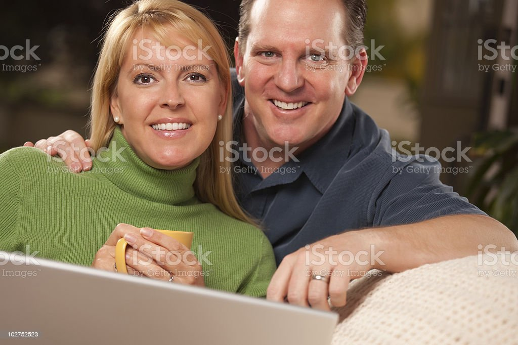 Handsome Couple Using Laptop Computer royalty-free stock photo