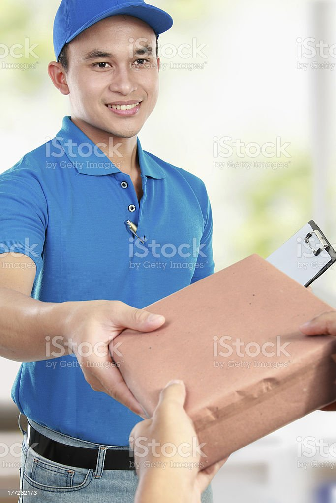 Handsome deliveryman with package royalty-free stock photo