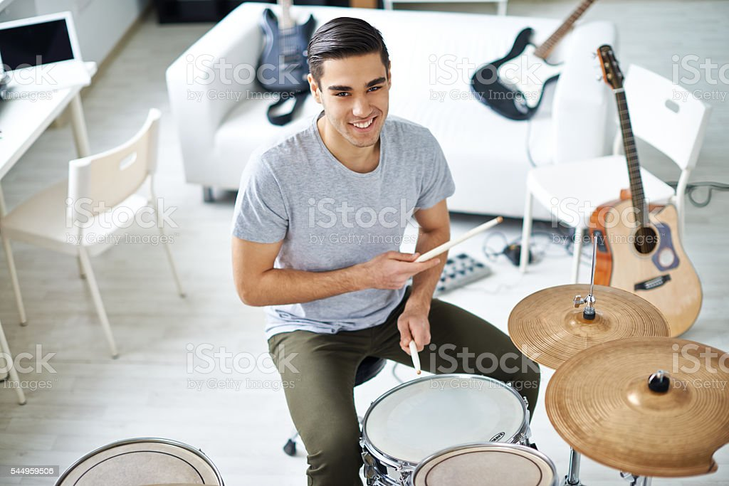 Handsome drummer stock photo